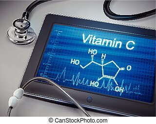 vitamin C words displayed on tablet with stethoscope over...