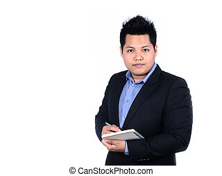 Young smiling Asian businessman taking notes isolated on a...