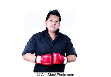 businessman with red boxing glove ready to fight with...