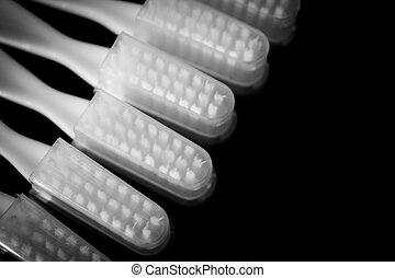 Toothbrushes heads - Toothbrushes teeth lying on black...