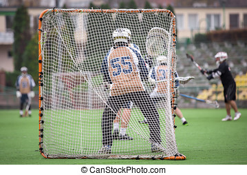 Lacrosse player on a field during the match