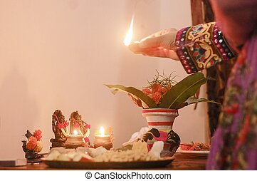 Worshipping lord Ganesha and godess Laxmi in an Indian home