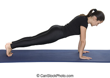 Plank pose - Young woman practicing yoga plank pose