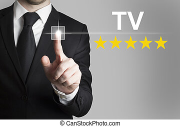 businessman pushing button tv five rating stars -...