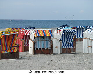 roofed wicker beach chairs  - in the mmorning
