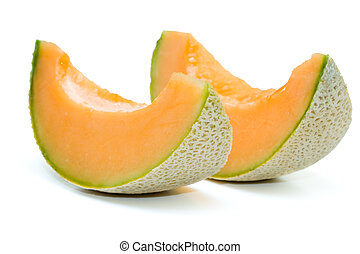 Melon - Close up of cantaloupe melon in isolated white...
