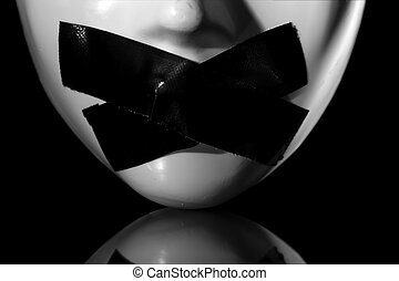 silenced mask - close up on masks mouth with masking tape on...