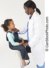 African American Female Doctor Examining Interracial Girl...