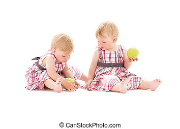 twins - picture of two adorable twins over white
