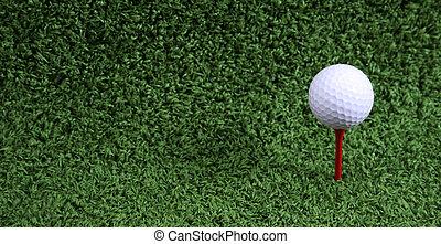 Golf Ball - Golf ball resting on peg in artificial grass mat