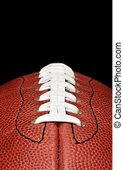 Football Closeup Isolated on Black - American football...