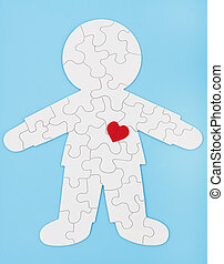 Puzzling Body - A white puzzle in the shape of a human body...