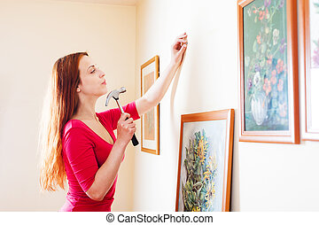 girl in red hanging  pictures