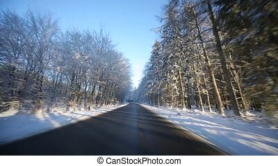 Driving on Highway in winter with sun - POV Video footage of...
