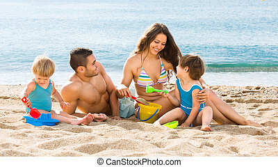 family with two children - Young family with two children...