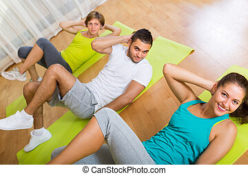 Fitness class in sport club - Positive group of three having...