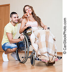 Young woman on wheelchair - Happy friends with smiling girl...