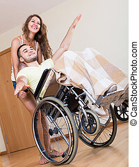 Smailing man on wheelchair - Happy friends with smiling man...