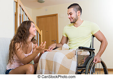man in wheelchair and girl having conversation - Handsome...