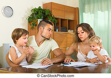 Parents with children having quarrel - Young married couple...