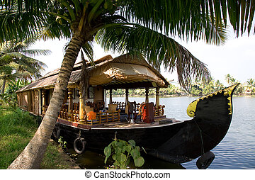 House boat in backwaters - House boat in India over tropical...
