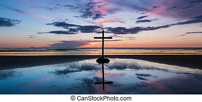 Centre Sunset Beach Cross. - Cross with a crown on sword on...