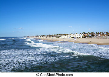 Shore of Huntington Beach - A panorama of the shoreline and...