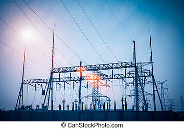 transformer substation silhouetted against dusk sky ,...