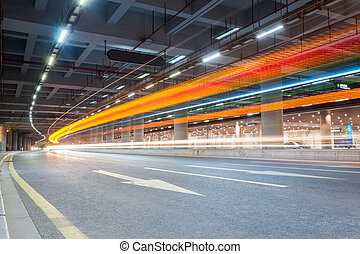 light trails on city road - light trails of vehicles in the...