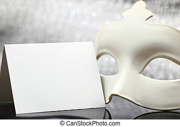 White mask in front of glittering background