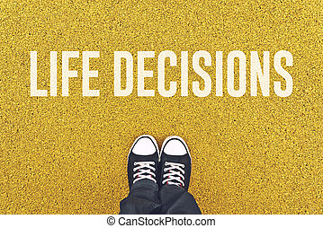 Young man standing at Life Decisions sign - Young man...