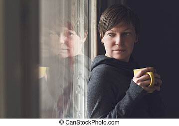 Beautiful Woman Drinking Coffee in Dark Room - Beautiful...