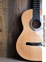 acoustic six-string guitar on the background of wooden...