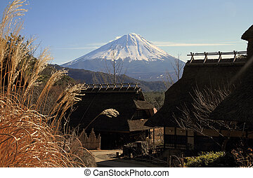 Japanese thatched roof house and Mt. Fuji