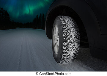 Good winter tires on snowy road - Northern lights