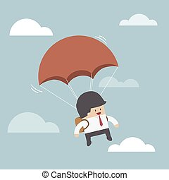 Businessman is flying with parachute