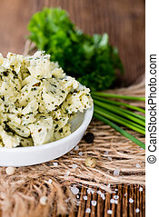 Herb Butter in a bowl - Herb Butter in a small bowl on...