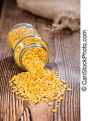 Portion of Yellow Lentils on vintage wooden background