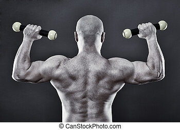Strong man with minuscule dumbbells - Funny image of a very...