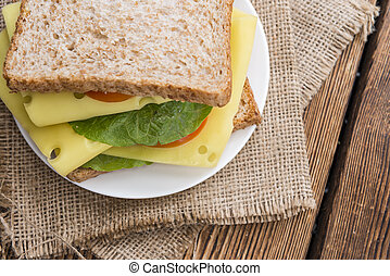 Fresh made Sandwich with Cheese on rustic wooden background...