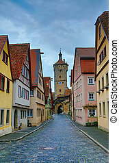 Narrow medieval street with hdr toning in Rothenburg,...