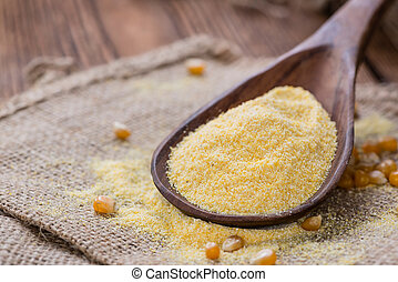 Cornmeal (on rustic background) - Portion of Cornmeal (on...