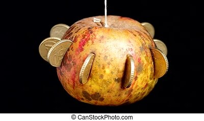 Apple with coins