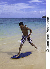 teenage boy on skim board - teenage boy on his skim board in...