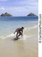 teenage boy on skim board - teenage boy on his skim board in...