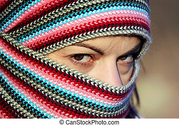 Woman in pied wrap - Portrait of hard looking young woman in...
