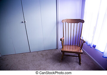 Rocking chair - Empty rocking chair in room next to window