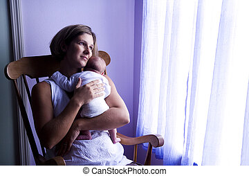 Mother rocking newborn - Mother holding newborn baby in...