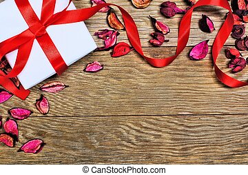 Valentines Day gifts - Gift box with scattered petals and...