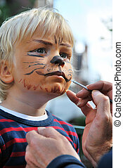The making of a lion - The face of a young child being made...